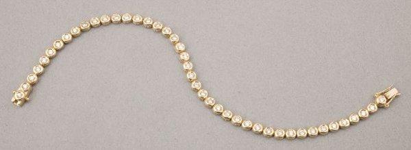 757: A 14K YELLOW GOLD AND DIAMOND BRACELET.