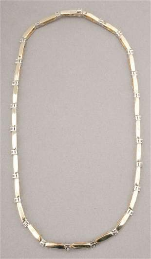 A 14K YELLOW GOLD AND DIAMOND NECKLACE.