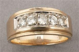 A 14K YELLOW GOLD AND DIAMOND RING. Of