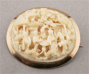 A YELLOW GOLD AND IVORY CAMEO. Designed