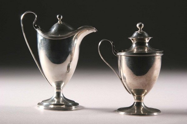 18: A GEORGE III SILVER MUSTARD POT AND A COVERED CREAM