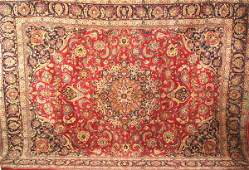 1246: A SEMI-ANTIQUE PERSIAN MASHAD RUG