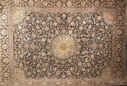 1249: A SEMI-ANTIQUE PERSIAN MASHAD RUG