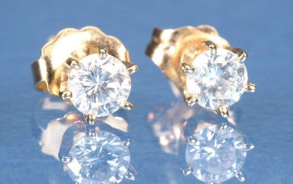 798: PAIR 14K YELLOW GOLD DIAMOND STUDS.