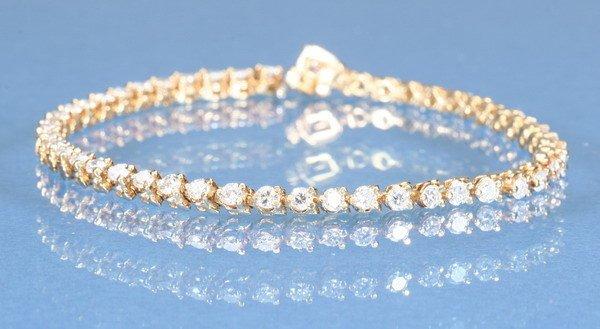 800: DIAMOND TENNIS BRACELET.