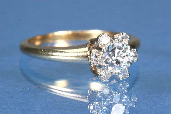 806: 14K YELLOW GOLD AND DIAMOND RING,