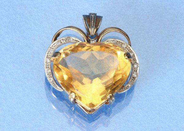 814: CITRINE AND DIAMOND PENDANT.
