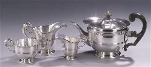 AN EDWARDIAN SILVER FOUR-PIECE TEA SERVIC