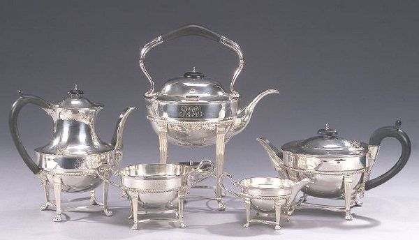AN ELIZABETH II SILVER FIVE-PIECE TEA AND