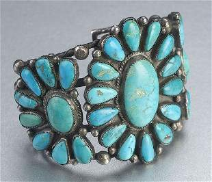 A NAVAJO SILVER AND TURQUOISE CUFF BRACE