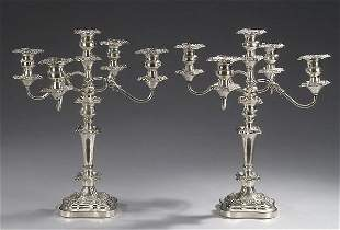 12: A PAIR OF SILVER PLATED CANDELABRA, mid-