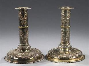 13: A PAIR OF SILVER PLATED CANDLESTICKS, ea
