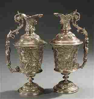 14: A PAIR OF SILVER PLATED EWERS, 20th cent