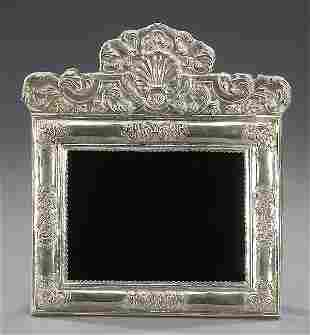 19: A SPANISH COLONIAL STYLE SILVER FRAME.