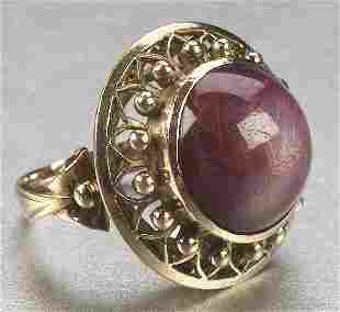 A 14K YELLOW GOLD AND RUBY RING, Circa