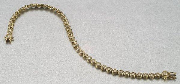 341: A 14K YELLOW GOLD AND DIAMOND BRACELET,