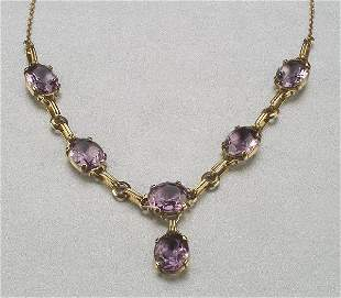 A 14K YELLOW GOLD AND AMETHYST NECKLACE,