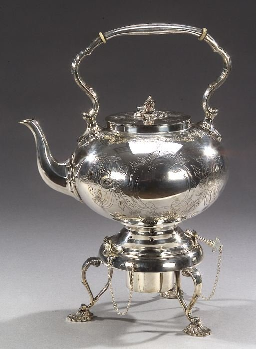 14: A VICTORIAN SILVER PLATED TEAPOT WITH BUR