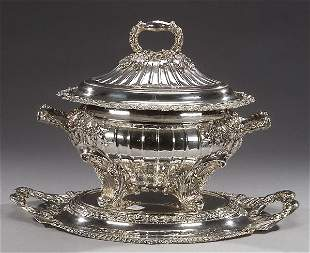 A STERLING LOUIS XV STYLE TUREEN ON STAND
