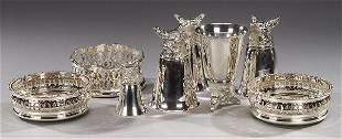 A COLLECTION OF SILVER PLATED WINE COASTE