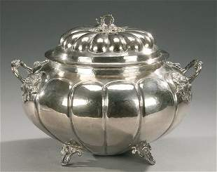 A PERUVIAN SILVERED TUREEN. With fruit an