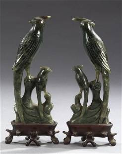 A PAIR OF CHINESE SPINACH JADE FIGURES O