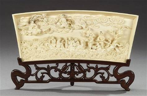 A CHINESE IVORY PLAQUE. Carved to depict