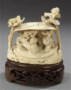 A CHINESE IVORY CARVING. Depicting schol