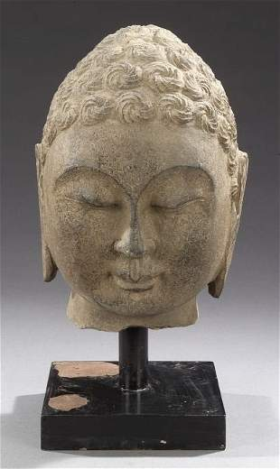 A CHINESE GREY STONE HEAD OF BUDDHA. His