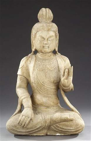 A CHINESE MARBLE FIGURE OF GUANYIN. Sea