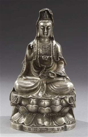 A CHINESE SILVERED BRONZE FIGURE OF GUA