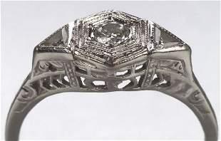 A 10K WHITE GOLD AND DIAMOND RING. Circa