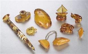 A COLLECTION OF BALTIC AMBER OBJETS. Inc