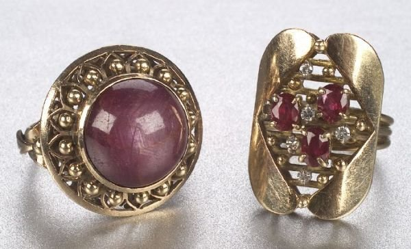 670: TWO 14K YELLOW GOLD AND RUBY RINGS. Incl