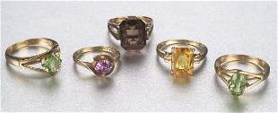 A GROUP OF SEMI-PRECIOUS STONE RINGS. In