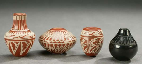 6: FOUR NATIVE AMERICAN MINIATURE CARVED POTTERY JARS,