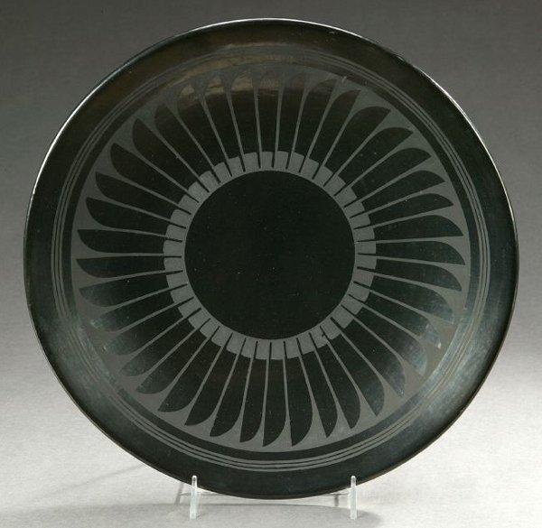 20: A NATIVE AMERICAN BLACK-WARE POTTERY PLATE, Maria M