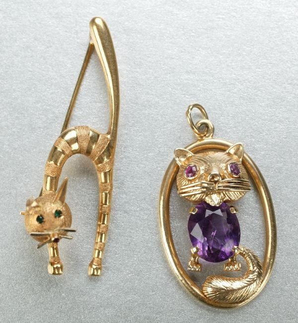 1267: A COLLECTION OF CAT JEWELRY.