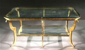 539 CONTEMPORARY GILTMETAL GLASSTOP COCKTAIL TABLE
