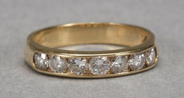 1002: 14K YELLOW GOLD AND DIAMOND BAND.