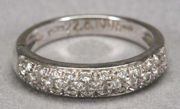 1012: 18K WHITE GOLD AND PAVE-SET DIAMOND BAND.