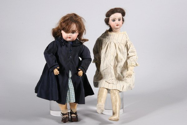 694: TWO PORCELAIN HEAD DOLLS, - First, 19 in. high, se