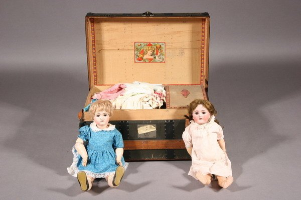 698: TWO PORCELAIN DOLLS WITH DOLL TRUNK AND CLOTHES, -