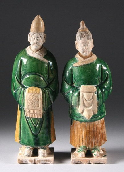 17: TWO CHINESE SANCAI EARTHENWARE FIGURES OF ATTENDANT