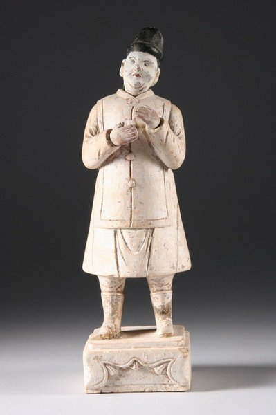 19: CHINESE POLYCHROME EARTHENWARE FIGURE OF ATTENDANT,