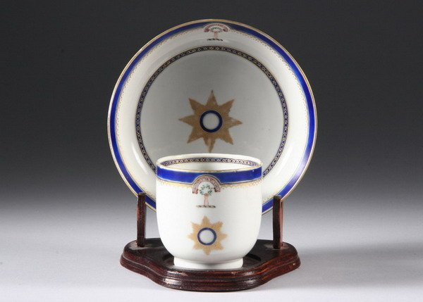 150: CHINESE EXPORT PORCELAIN CRESTED CUP AND SAUCER. L