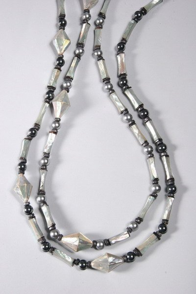 1030: TWO MOTHER-OF-PEARL NECKLACES, SYLVIA GOTTWALD.
