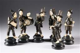 1118: SIX SOUTH GERMAN WOOD AND IVORY FIGURES OF MUSICI