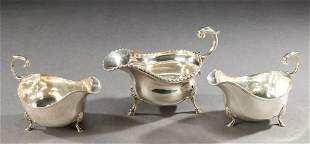 A VICTORIAN SILVER SAUCE BOAT AND A PAIR OF EDWARD V