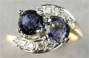 AN 18K YELLOW GOLD, IOLITE AND DIAMOND RING.